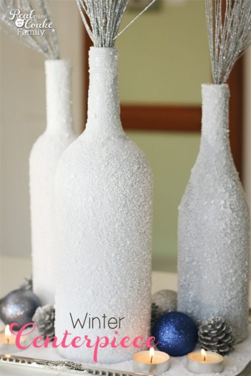 Gorgeous DIY winter Centerpiece made from wine bottles and epsom salt. This will be perfect in my home decor!