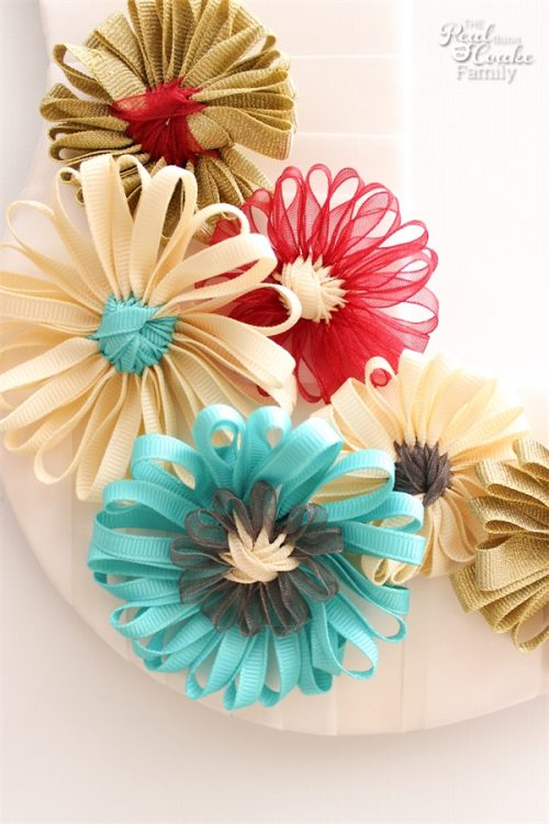 What a fun idea! Take an unfinished wood picture frame and turn it into a diy wreath with cute ribbon flowers. Great inexpensive idea for my home decor.