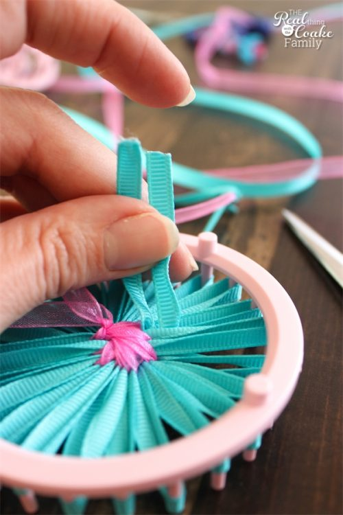 I love simple crafts like these single layer ribbon flowers. Cute and easy! There is a full tutorial on how to make a flower from ribbon.