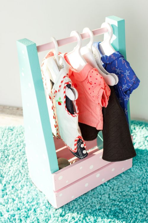 Cuteness! This is such a cute DIY American Girl idea to make a portable clothes closet. Perfect to hold all the American Girl Doll stuff and accessories.