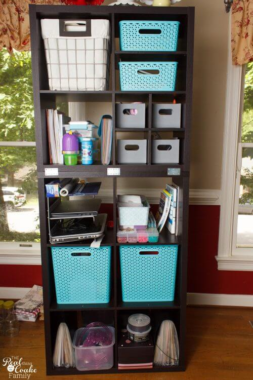Great DIY showing how to connect freestanding bookshelves or storage cubes together. Perfect IKEA hack to use with the Kallax or Billy Bookcases to make our house safer and make an inexpensive custom look