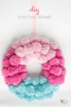 Cute DIY pom pom wreath tutorial showing step by step how to make this easy wreath using a pom pom maker. Perfect pom pom crafts for your home decor.