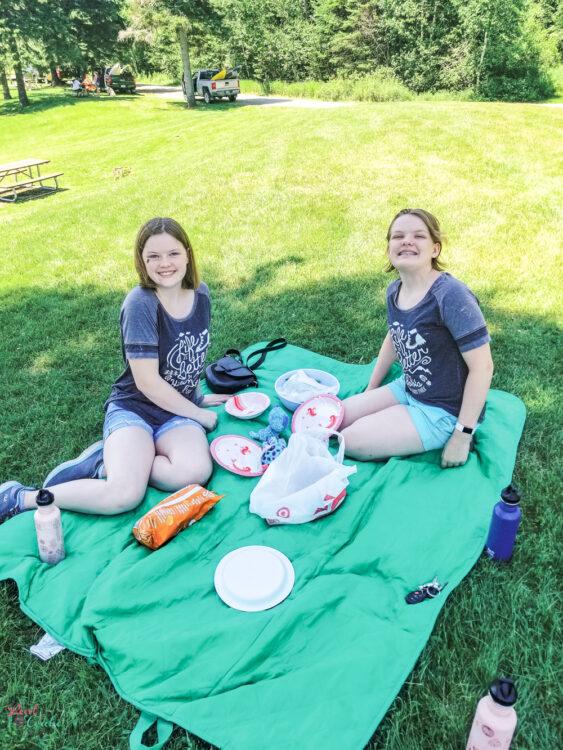 2 girls having picnic at 1st Connecticut Lake
