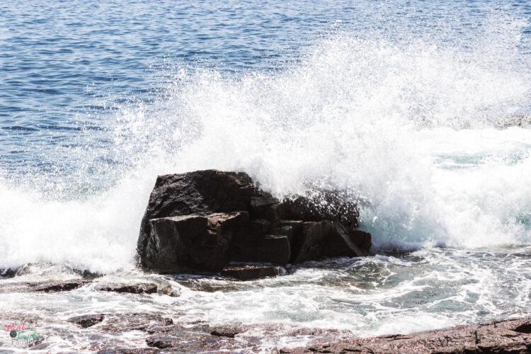 waves crashing into rocks at Acadia National Park