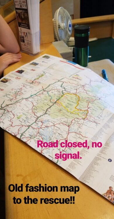 paper map of New Hampshire with wording road closed, no signal