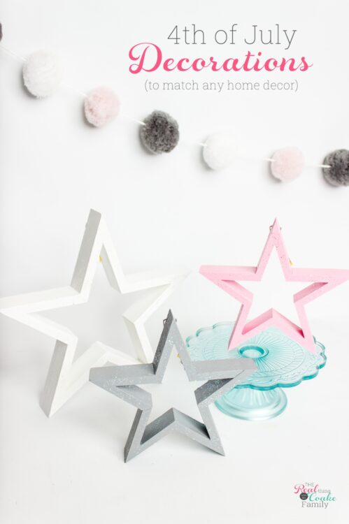 3 wood stars painted with white, pink, and gray paint and glitter paint.