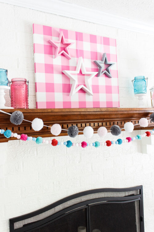 pink, white, and gray stars shown on mantel in home decor