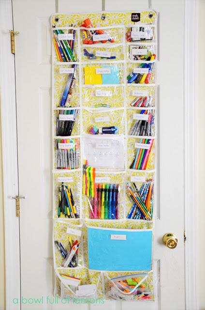 school supplies organized in over door shoe holder