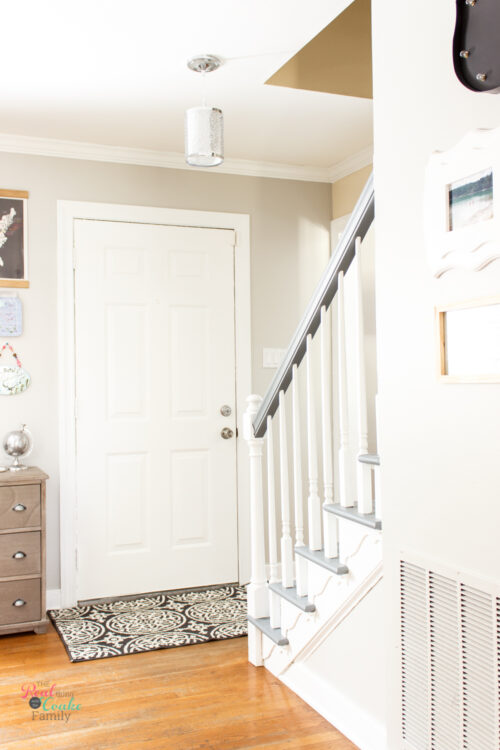hallway with grey and white painted staircase