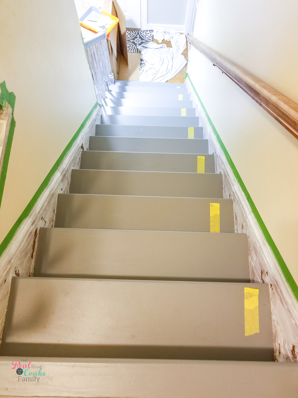 delicate painters tape on every other tread to show where to walk when painting stair treads