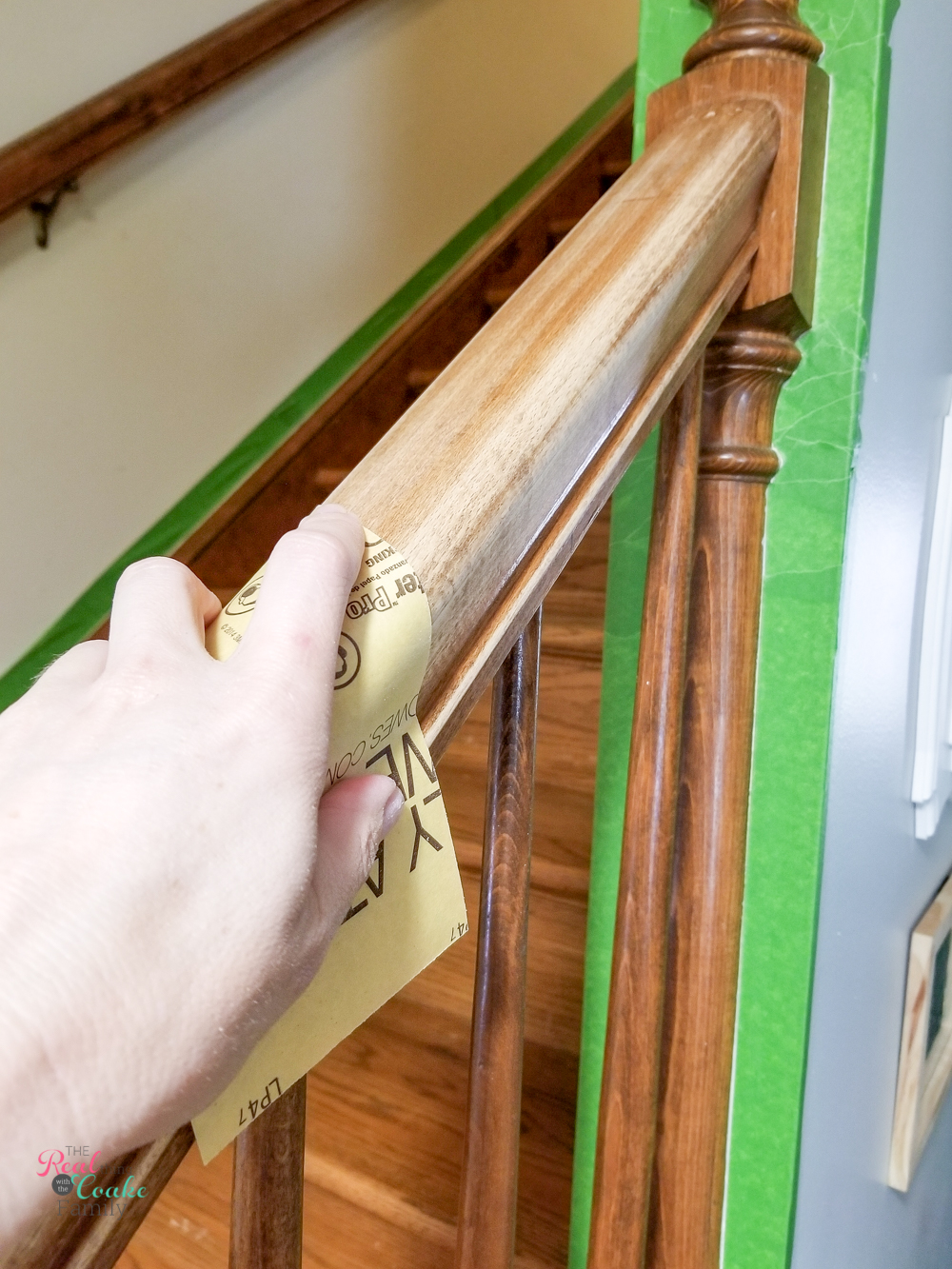 sanding railings to prep for painting stairs