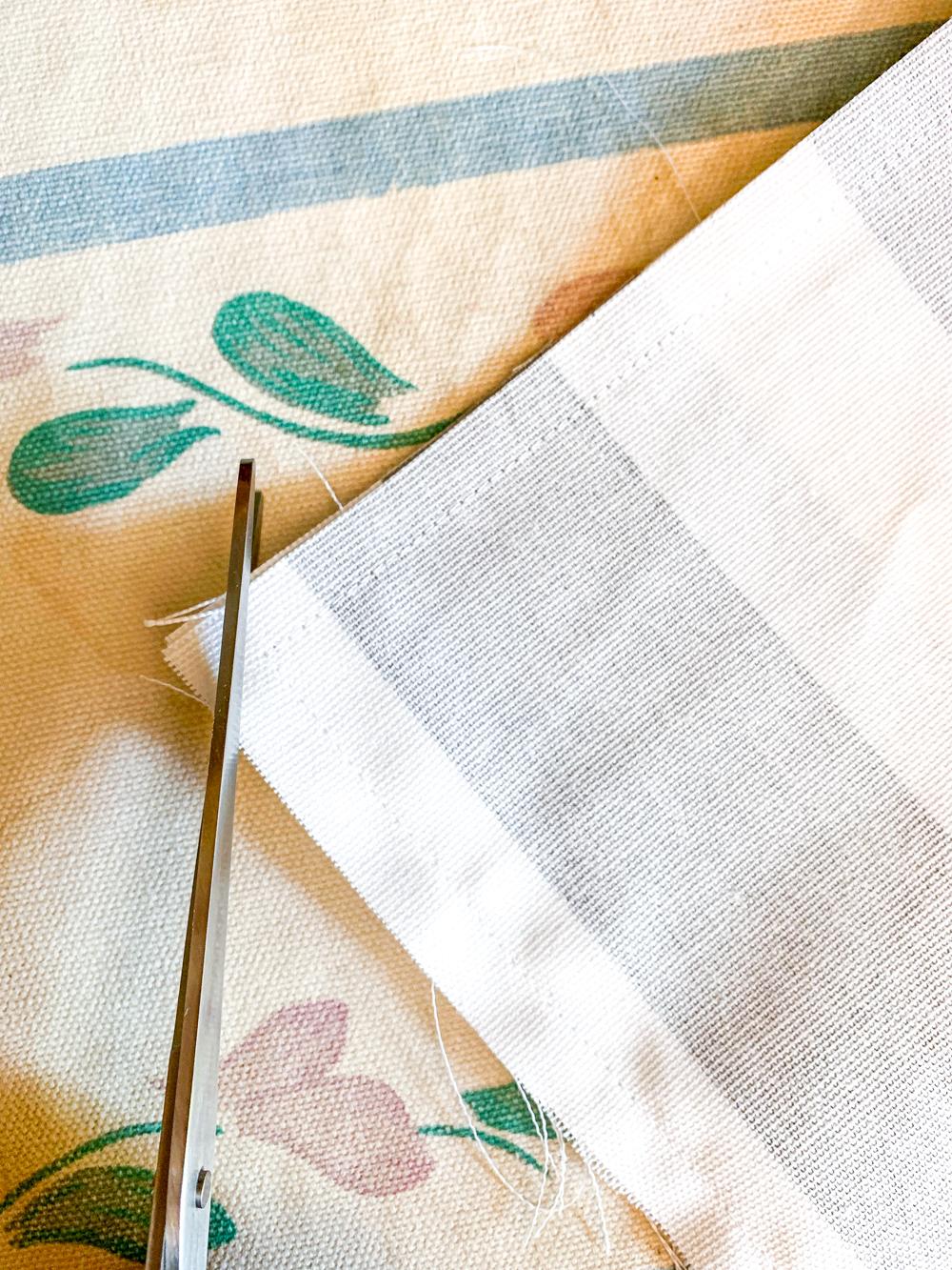 scissors clipping corner of fabric