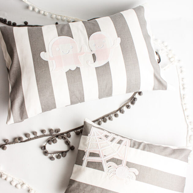 grey, white and pink halloween pillows