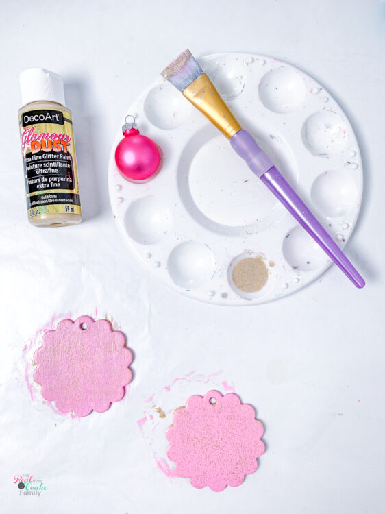 glamour dust paint with paintbrush and chipboard tags painted pink with glitter paint