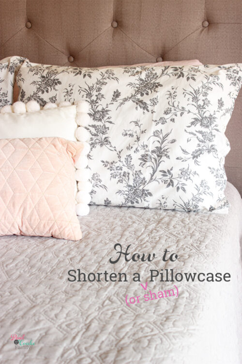 shortened pillow sham on bed with decorative pillows